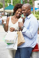 African American couple with shopping bags