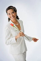 Portrait of Hispanic woman holding rose