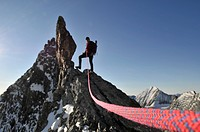 Male mountain hiker standing on mountain peak, Trentino_Alto Adige, Italy