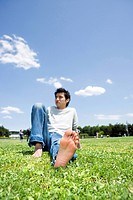 Young man sitting on the grass
