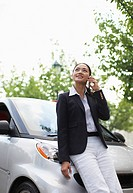 Mid_Adult Woman on Cell Phone by Smart Car
