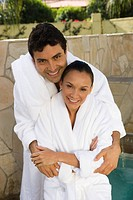 Portrait of couple in bathrobes outdoors