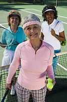 Three women on tennis court portrait
