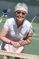 Senior woman playing tennis portrait