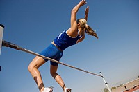 Female athlete high_jumping low angle view