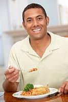 Man Enjoying A Meal At Home