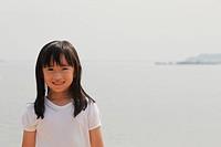 Young girl smiling at camera.
