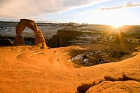 Delicate Arch basks in warm sunset glow on a cold winter afternoon, Arches National Park, Utah, USA