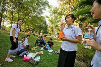 Laos, Vientiane, group of students relaxing in one of the park in the town centre.