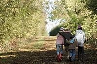 Children walking up country lane