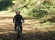 Boy riding bike in countryside
