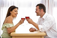 Young couple at home celebrating