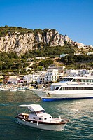 View of harbour, boats, buildings and mountains, Marina Grande, Capri, Italy