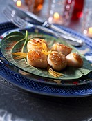 Pan_fried scallops with harissa oil and confit lemon