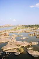 Rock on a water surface, Hampi, Karnataka, India