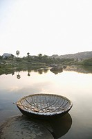 Traditional basket boat in a river, Hampi, Karnataka, India