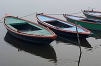 High angle view of boats moored in a river, Ganges River, Varanasi, Uttar Pradesh, India