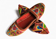 Close_up of two pairs of colorful traditional footwear