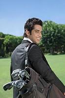 Businessman carrying a golf bag