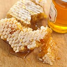 Honeycomb and jar of honey