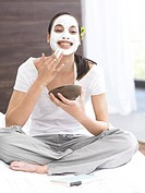 Dark_haired woman with face mask