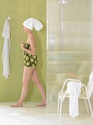 Woman getting out of shower (thumbnail)