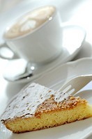 Cappuccino with milk froth and pie slice