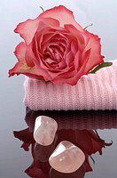 Healing stone rose quartz with a single rose