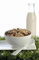 Fruit muesli and milk bottle