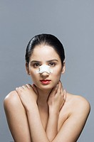 Portrait of a woman with her nose bandaged
