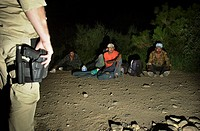 BORSTAR agents of the U.S. Border Patrol process undocumented migrants who crossed illegally from Mexico in to the United States on the Tohono O´odham...