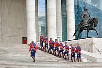 Mongolian soldiers march up the steps at the Government House alongside a Genghis Khan statue, Ulaan Baatar, Mongolia No releases available