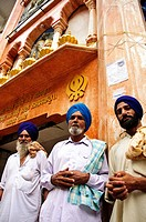 Sikh men standing in front of Gurdwara Shri Guru Nanak Dev Ji Manikaren, Himachal Pradesh, India