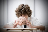 Boy with model brain