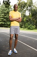 Runner with crossed arms