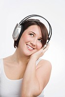 A teenage girl listening to music (thumbnail)