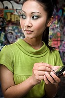 A young woman using a handheld computer