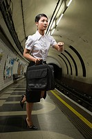 A businesswoman on a subway platform