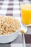 Bowl of cereal and a glass of orange juice