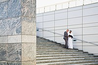 Businessmen on steps (thumbnail)