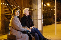 Couple at bus shelter