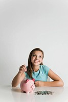 Girl with piggy bank and coins