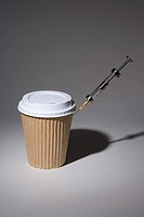 A syringe in a paper coffee cup (thumbnail)