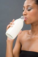 Woman drinking a pint of milk