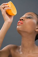 Woman squeezing an orange