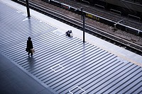Commuter standing on a platform