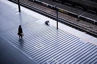 Commuter standing on a platform