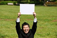 A Young Japanese Man Holding White Board