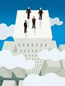 Four businessmen standing on top of the tallest building above the clouds