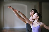 Teenager ballet dancers practicing together